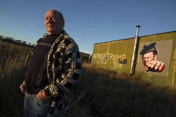 Michael Forbes, a quarry worker whose home sits on the opposite side of President-elect Donald Trump�s golf course, in Balmedie, Scotland, Nov. 18, 2016. Forbes, whom Trump called a �disgrace� for refusing to sell his home, flies a �Hillary for President� flag near the property line - part of a trail of unmet promises on one of his golf courses, and lashed out at homeowners who stood in his way. (Jeremy Sutton-Hibbert/The New York Times)