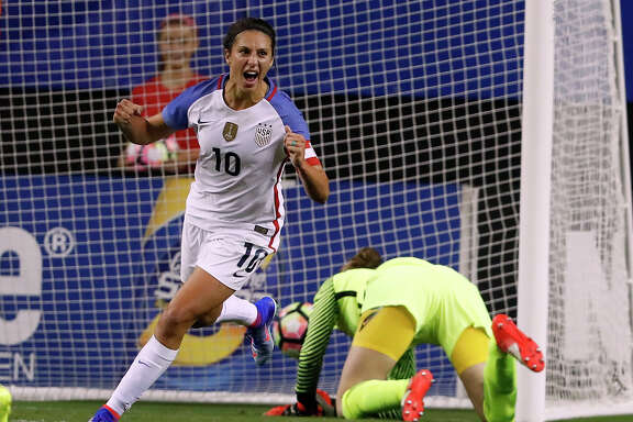 USA's Carli lloyd (10) celebrates after beating Netherlands goal keeper Sari van Veenendaal for a goal in the first half of an exhibition soccer match, Sunday, Sept. 18, 2016, in Atlanta. (AP Photo/John Bazemore)
