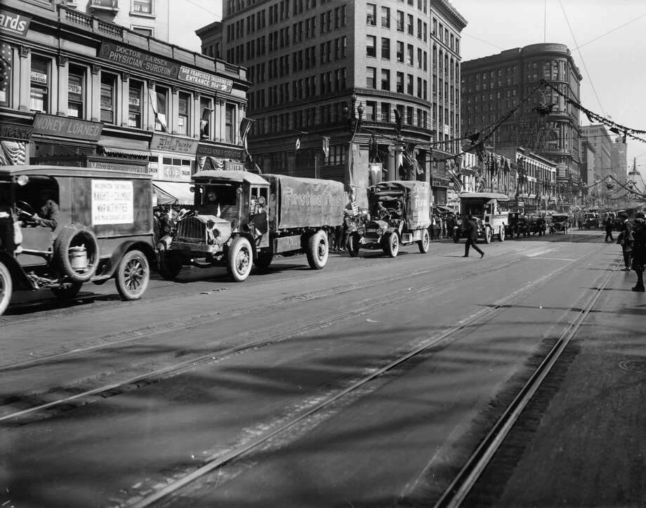 The 20s: Trucks in Market Street, San Francisco in 1922. The second and third trucks are a Packard and a White respectively. Photo: Heritage Images/Heritage Images/Getty Images