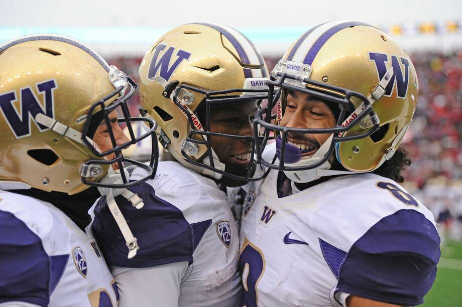 Washington Huskies wide receiver Dante Pettis celebrates a touchdown with his teammate against the Washington State Cougars during the first half at Martin Stadium. Photo: James Snook/USA Today Sports, /via Reuters