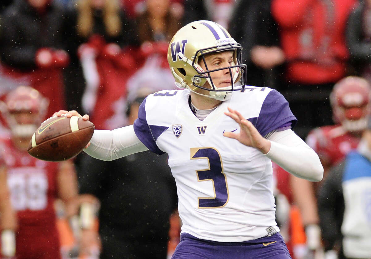Nov 25, 2016; Pullman, WA, USA; Washington Huskies quarterback Jake Browning (3) drops back for a pass against the Washington State Cougars during the first half at Martin Stadium. Mandatory Credit: James Snook-USA TODAY Sports