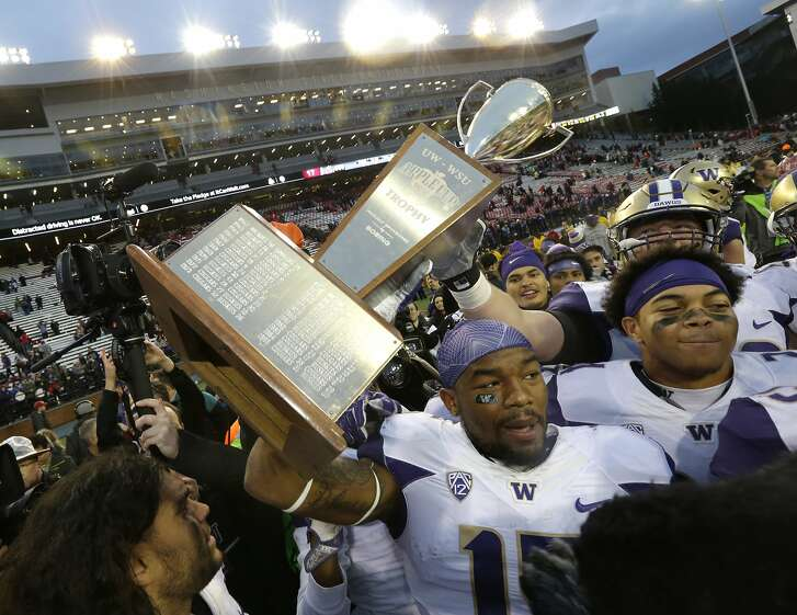 Washington tight end Darrell Daniels holds the Apple Cup trophy after Washington beat Washington State 45-17 in an NCAA college football game, Friday, Nov. 25, 2016, in Pullman, Wash. Washington beat Washington State 45-17. (AP Photo/Ted S. Warren)