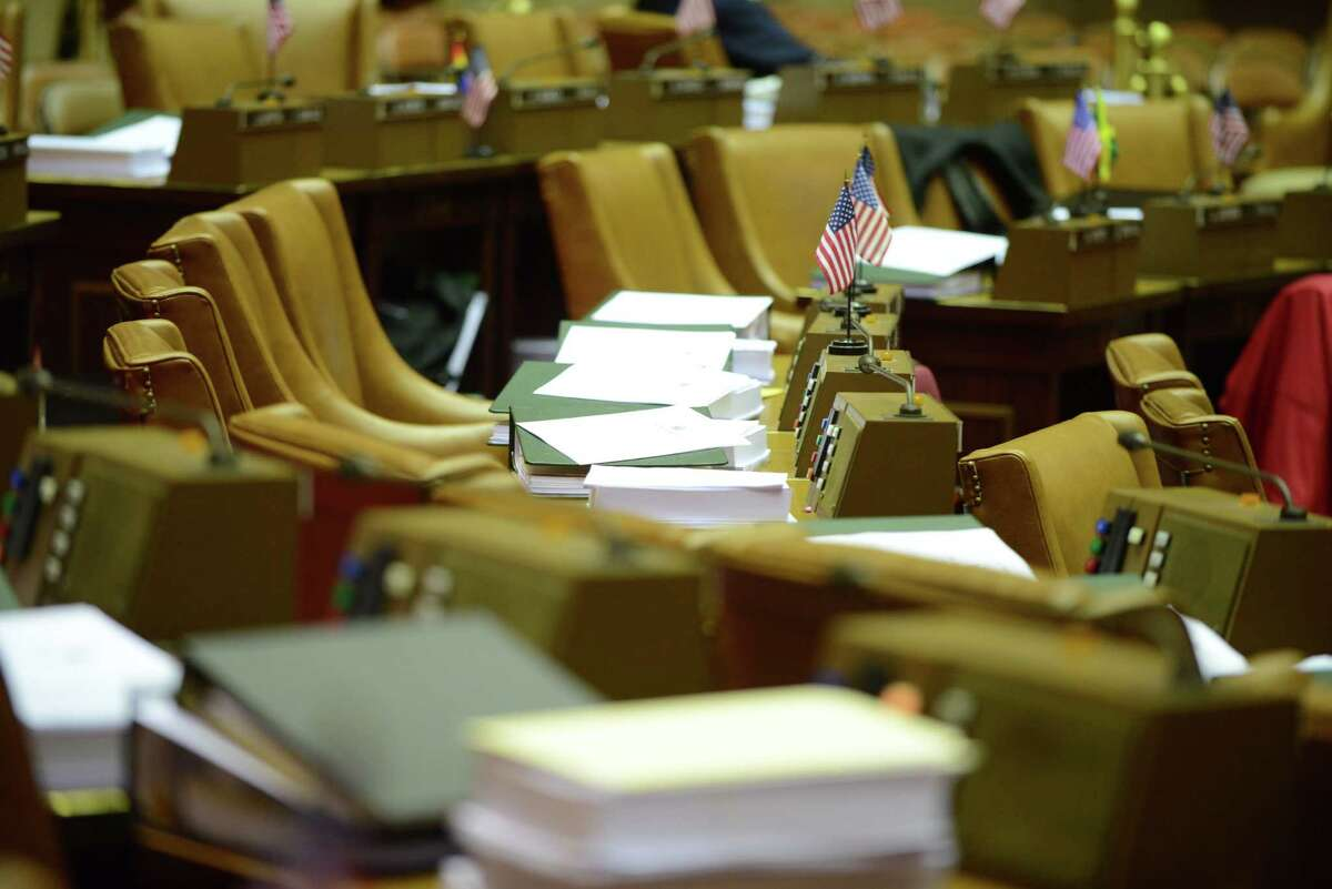 Bills sit on the desks of lawmakers in the Assembly Chamber on Monday afternoon, March 30, 2015, at the Capitol in Albany, N.Y. The Legislature has yet to hand up 25 bills passed during the 2016 legislative session, though there isn?t any imminent requirement that they do so. (Will Waldron/Times Union archive)