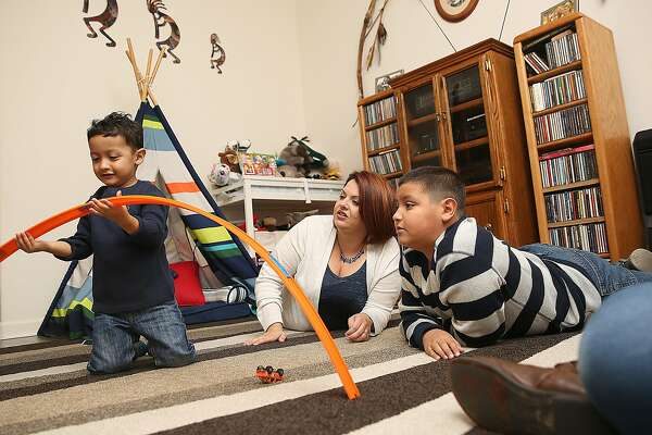 Xavier Pequeno (left), 3 years old,  with his mother Jessica Pequeno (middle) and brother Higinio Pequeno (right) play on Friday, November 25, 2016, in Napa, Calif.
