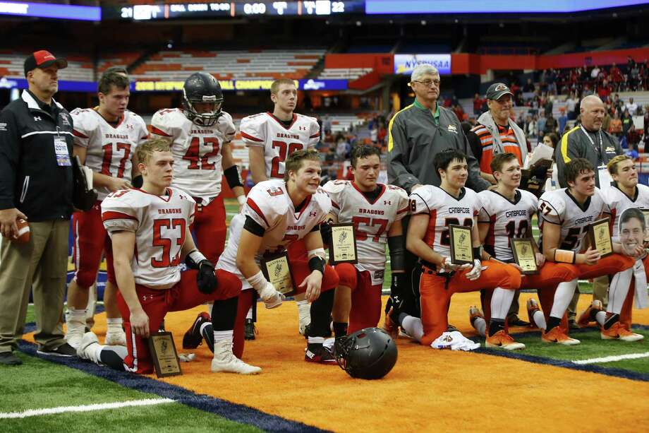 Maple Grove and Cambridge  award winner after  Cambridge won in double overtime for the New York State Class D Final at the Carrier Dome on Friday, Nov. 25, 2016.(Harry Scull Jr. / Buffalo News) Photo: Harry Scull Jr / Copyright 2016, The Buffalo News