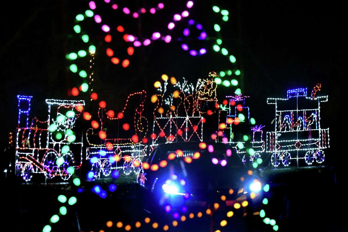A car drives through the 20th Annual Price Chopper Capital Holiday Lights in the Park on Friday, Nov 25, 2016, at Washington Park in Albany, N.Y. (Cindy Schultz / Times Union)