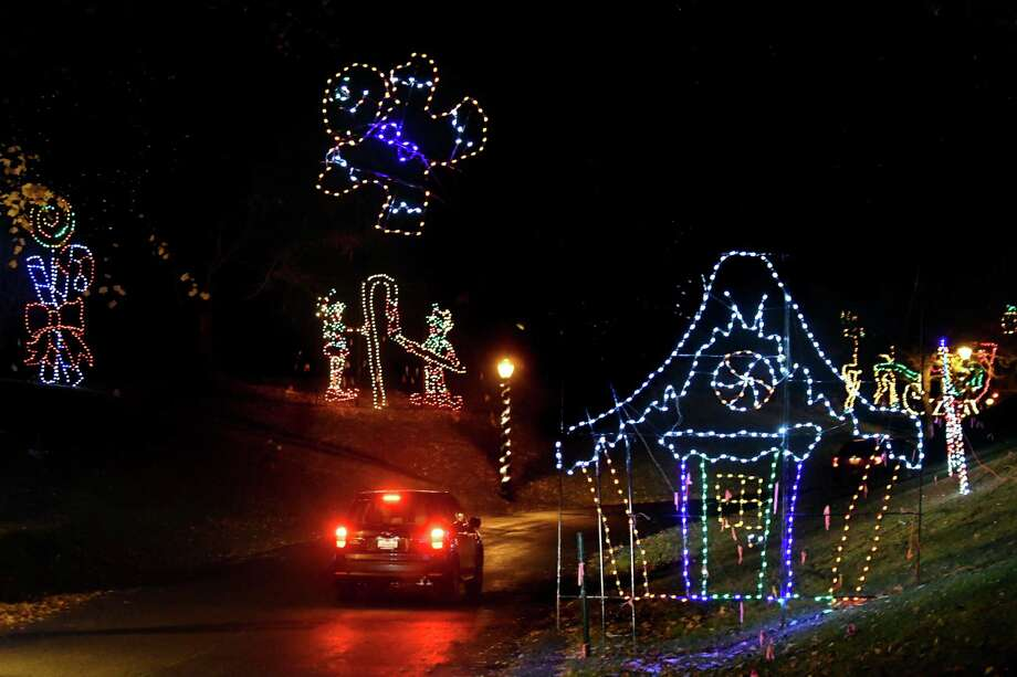 A car drives through the 20th Annual Price Chopper Capital Holiday Lights in the Park on : lighting albany ny - www.canuckmediamonitor.org