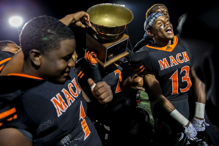 McClymonds Warriors quarterback Emoreea Fountain (1) and Angelo Garrett (13) celebrate after winning against the Castlemont Knights during the Oakland Athletic League Silver Bowl championship football game at Laney College, on Friday, Nov. 25, 2016 in Oakland, Calif. Photo: Santiago Mejia, The Chronicle