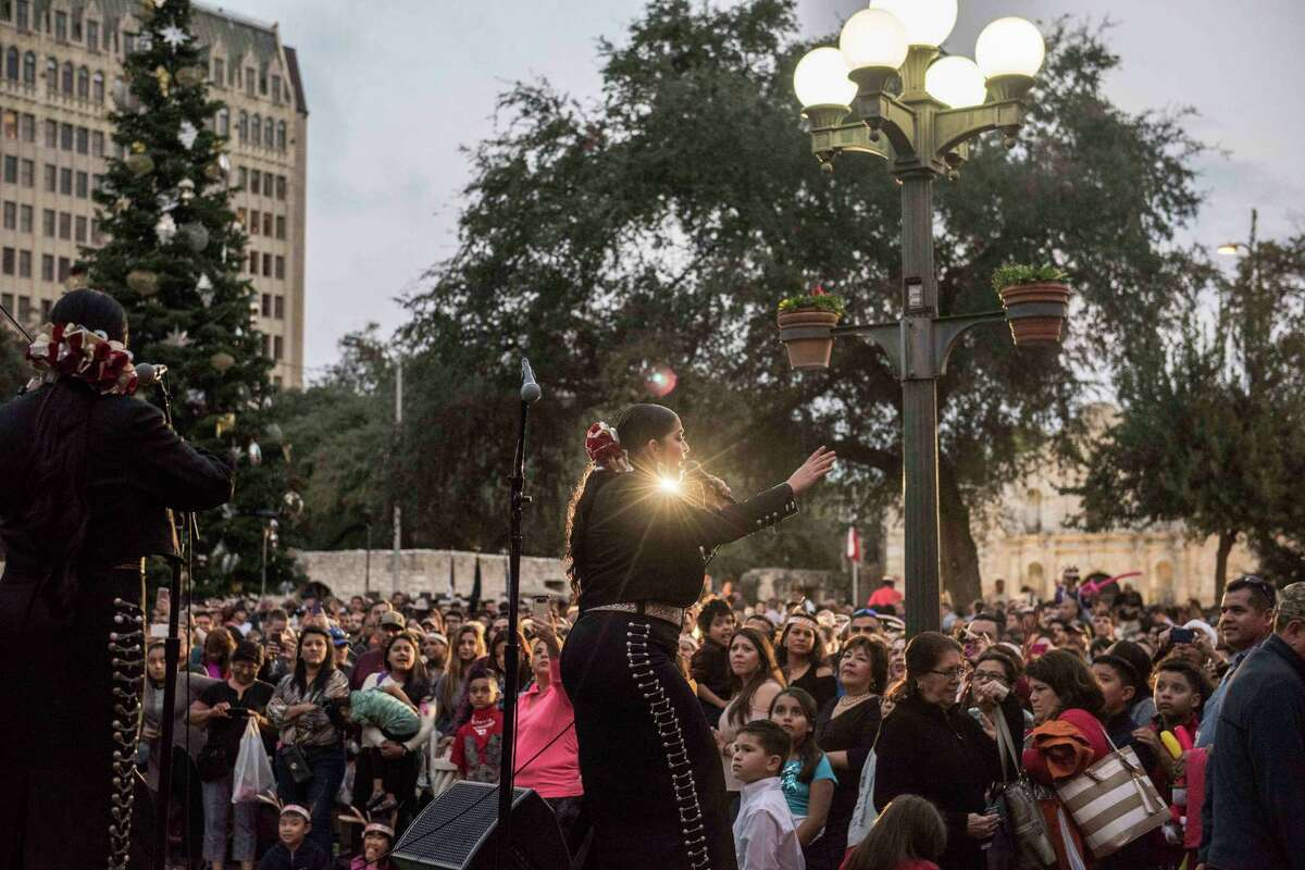 Members of the all female Mariachi band Las Altenas perform before the 32nd Annual H-E-B Tree Lighting and the Ford Holiday River Parade on Friday, November 25, 2016.