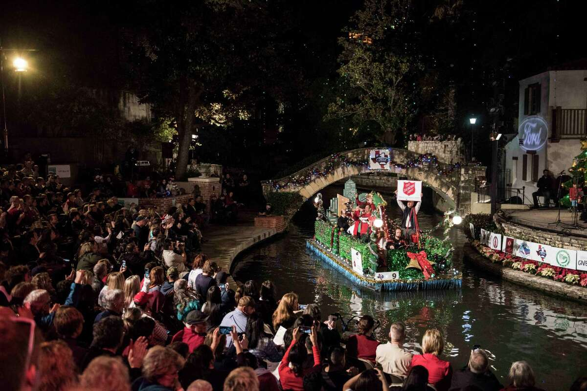 The Salvation Army float passes through the Arneson River Theater during the 2016 Ford Holiday River Parade Friday Nov. 25, 2016.