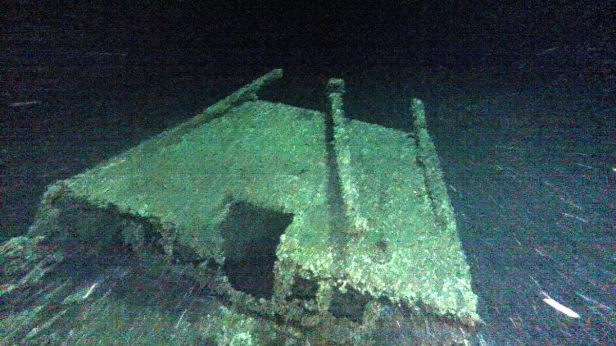 """In this undated photo provided by Roger Pawlowski, the cabin and tiller of the """"Black Duck"""" is shown in 350 feet of water off Oswego, N.Y. Underwater explorers say they've found the 144-year-old Lake Ontario shipwreck of the rare sailing vessel that typically wasn't used on the Great Lakes. Underwater explorer Jim Kennard says the Black Duck is believed to be the only fully intact scow-sloop to exist in the Great Lakes. (Roger Pawlowski via AP) ORG XMIT: NYR403"""