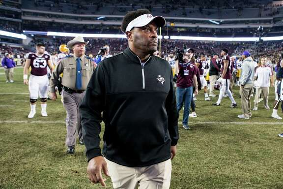 Texas A&M coach Kevin Sumlin walks off the field after a 54-39 loss to LSU at Kyle Field on Thursday. Sumlin is expected back at A&M next season.