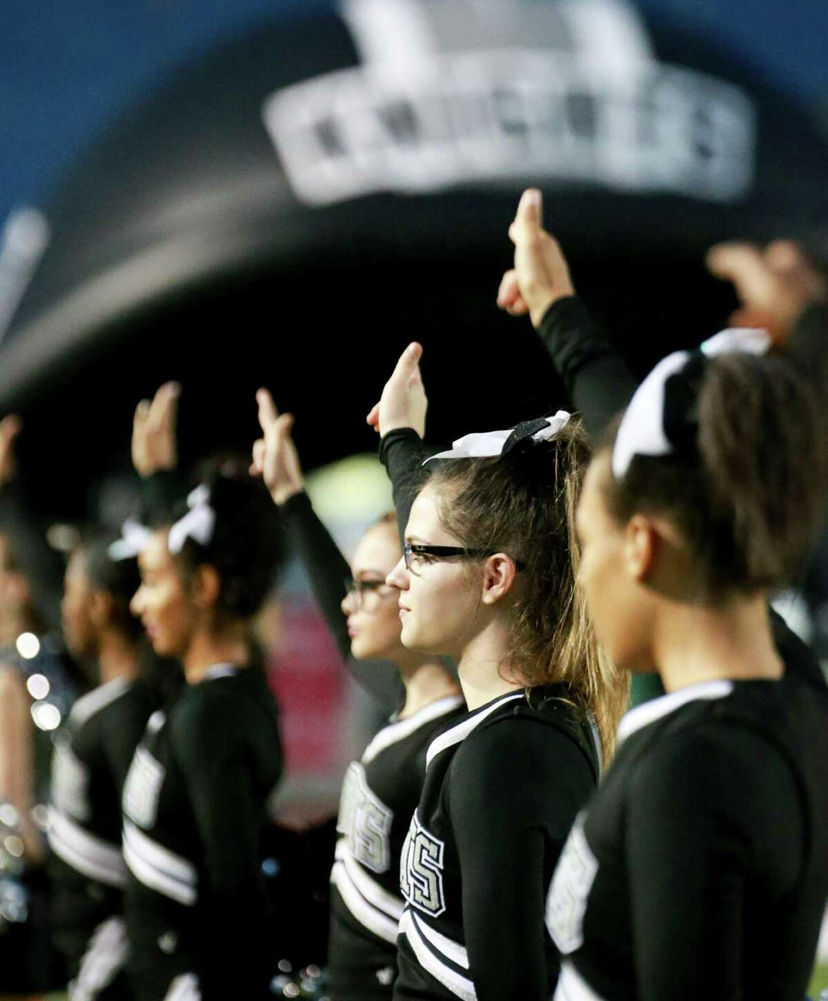 Freshman cheerleader Hollis Campbell stands with the rest of the cheer squad before the kickoff at Buccaneer Stadium in Corpus Christi on November 25, 2016.