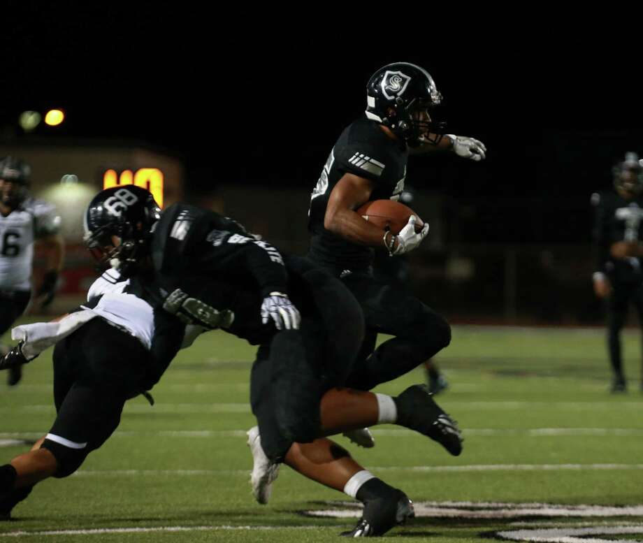 Steele's Brendan Brady (25) makes a cut to the inside after a block from Peter Sele (68) in the Class 6A Division II third-round playoff game between Steele and Weslaco East at Buccaneer Stadium in Corpus Christi on November 25, 2016. Photo: Tracy Weddle / Tracy Weddle/For The Express News