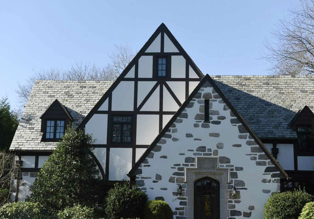 A house built in a Tudor style at 214 Hubbard Ave. is located in the Hubbard Heights neighborhood of Stamford, Conn. Wednesday, Nov. 23, 2016. Hubbard Heights, located along Hubbard Avenue and its sidestreets near the hospital, is one of the oldest neighborhoods in Stamford and has just been placed on the National Register of Historic Places. There is a variety of different architectural styles shown in the houses in the neighborhood.