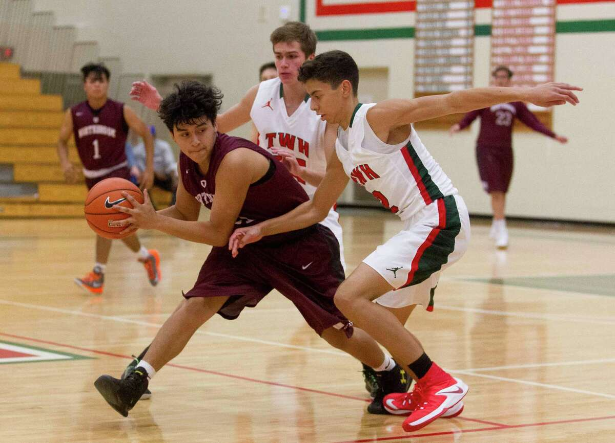 The Woodlands guards Gabe Carbajal (24) and Sammy Williams (25) double team Northbrook center Stephen Alderette (23) in the third quarter of a high school boys basketball game during the Guy V. Lewis Invitational at The Woodlands High School Friday, Nov. 25, 2016, in The Woodlands. The Woodlands defeated Northbrook 81-34.