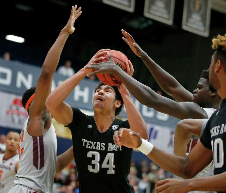 Texas A&M's Tyler Davis (34) fights through the Virginia Tech defense during the first half of an NCAA college basketball game at the Wooden Legacy tournament Friday, Nov. 25, 2016, in Fullerton, Calif. (AP Photo/Christine Cotter) Photo: Christine Cotter, FRE / FR170214 AP