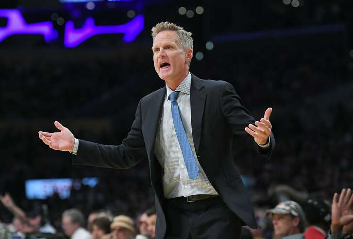 Golden State Warriors head coach Steve Kerr gestures to referees during the first half of an NBA basketball game against the Los Angeles Lakers, Friday, Nov. 25, 2016, in Los Angeles. (AP Photo/Mark J. Terrill)