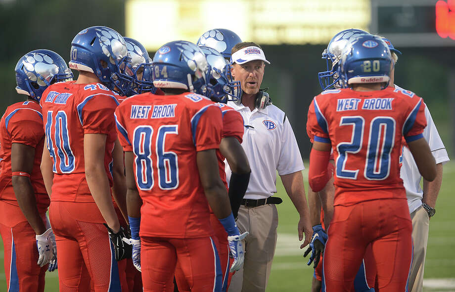 West Brook's head coach Kevin Flanigan gives starters advice before taking the field against  Channelview during Thursday night's match-up at the Thomas Center in Beaumont.