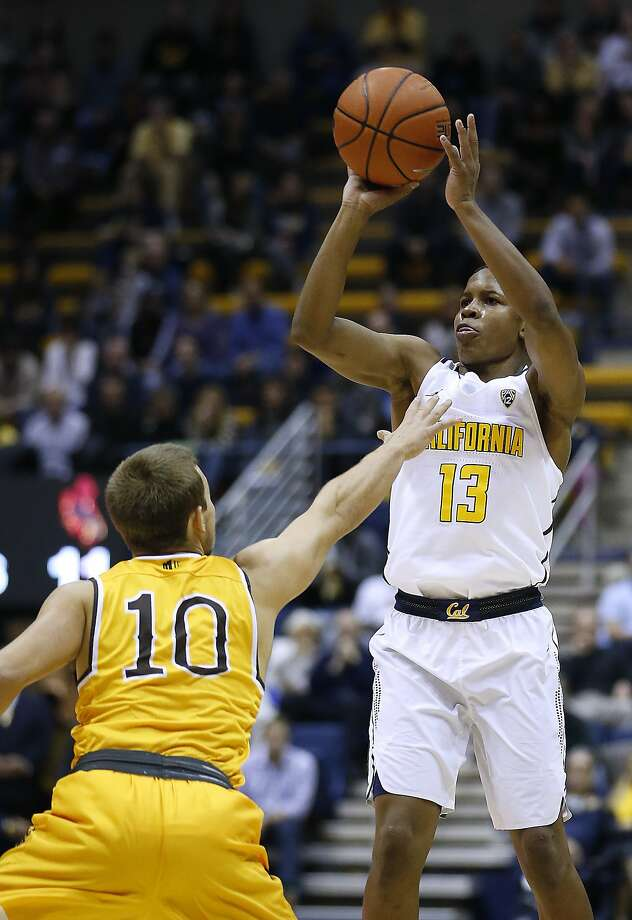 California guard Charlie Moore (13) shoots over Wyoming's Brandon Chauca (10) during the first half of an NCAA college basketball game Friday, Nov. 25, 2016, in Berkeley, Calif. (AP Photo/Tony Avelar) Photo: Tony Avelar, Associated Press
