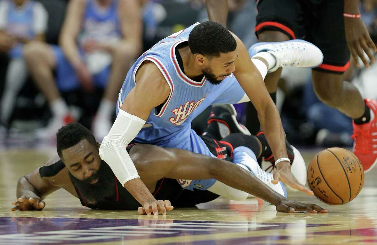 Houston Rockets guard James Harden, left, and Sacramento Kings guard Garrett Temple scramble for the ball during the second half of an NBA basketball game in Sacramento, Calif., Friday, Nov. 25, 2016. The Rockets won 117-104. (AP Photo/Rich Pedroncelli)