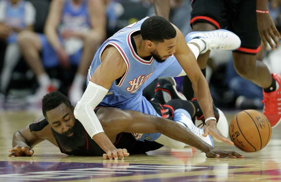Houston Rockets guard James Harden, left, and Sacramento Kings guard Garrett Temple scramble for the ball during the second half of an NBA basketball game in Sacramento, Calif., Friday, Nov. 25, 2016. The Rockets won 117-104. (AP Photo/Rich Pedroncelli) Photo: Rich Pedroncelli, Associated Press / Copyright 2016 The Associated Press. All rights reserved.