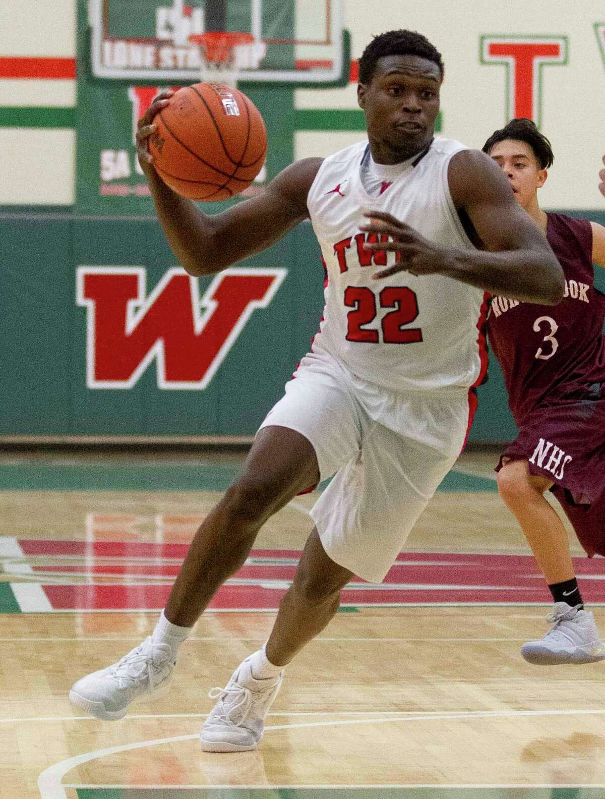 The Woodlands guard Romello Wilbert (22) drives the ball toward the paint in the second quarter of a high school boys basketball game during the Guy V. Lewis Invitational at The Woodlands High School Friday, Nov. 25, 2016, in The Woodlands. The Woodlands defeated Northbrook 81-34.