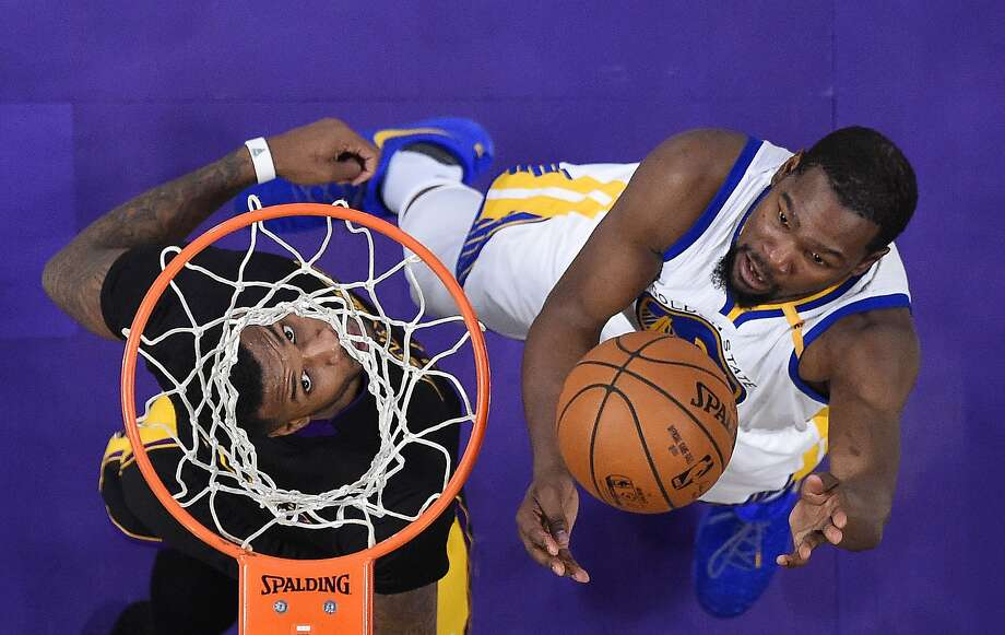 Golden State Warriors forward Kevin Durant, right, shoots as Los Angeles Lakers forward Thomas Robinson defends during the second half of an NBA basketball game, Friday, Nov. 25, 2016, in Los Angeles. The Warriors won 109-85. (AP Photo/Mark J. Terrill) Photo: Mark J. Terrill, Associated Press