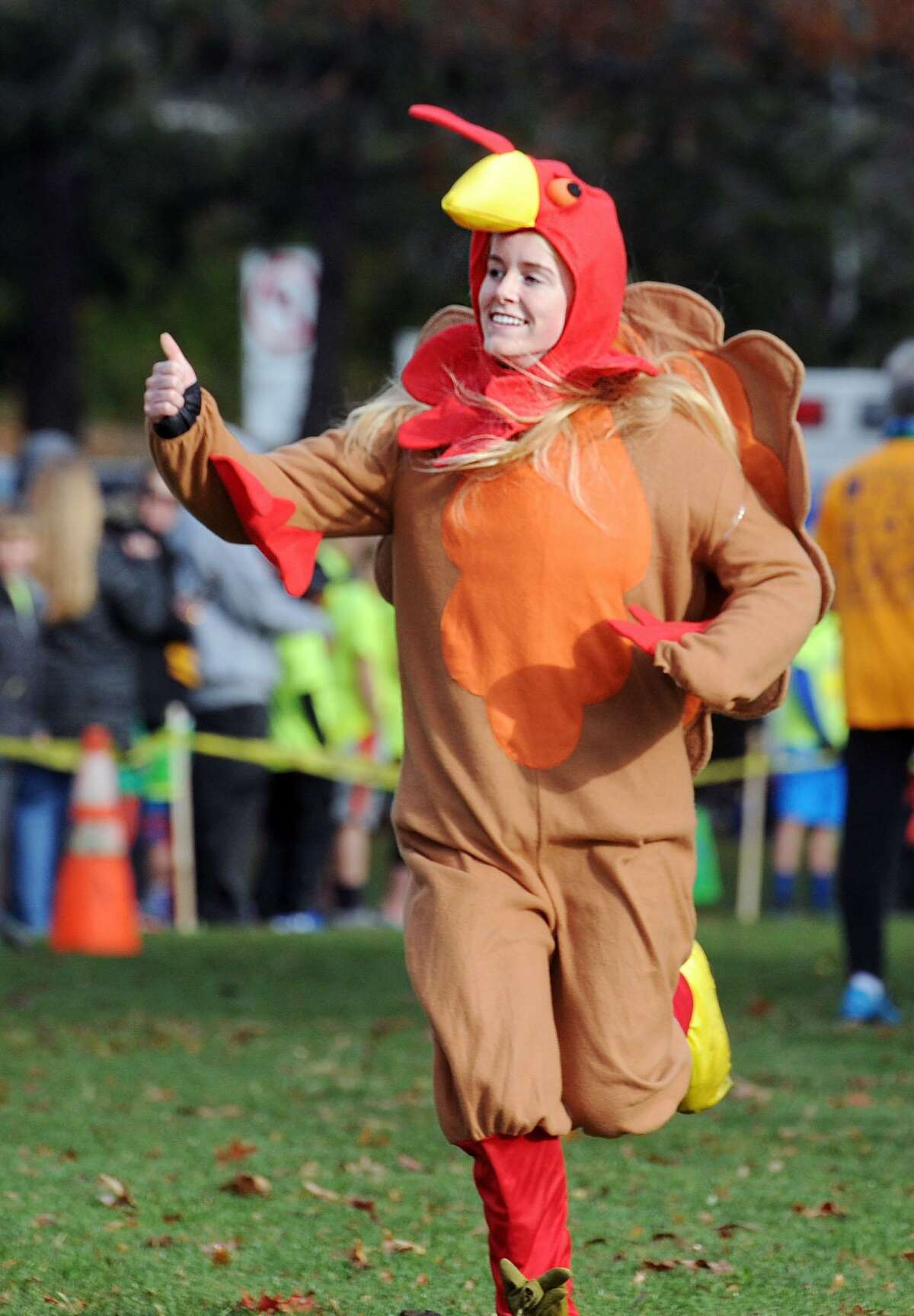 Kara Bittman, 16, of Greenwich, went full turkey with a costume as she participated in the Greenwich Alliance for Education's annual Turkey Trot starting at the Arch Street Teen Center in Greenwich, Conn., Saturday morning, Nov.26, 2016. Race official Mickey Yardis said over1,000 runners participated in the fund-raising benefit race. All proceeds from the race go to foster the Alliance's educational success programs for the Greenwich Public Schools.