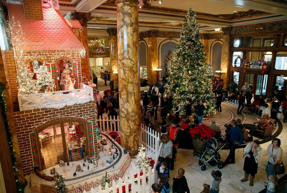 The Fairmont Hotel's two-story gingerbread house opens for the holiday season in San Francisco, Calif. on Saturday, Nov. 26, 2016. The 22-foot-high house features 7,750 pieces of gingerbread, 1,500 pounds of icing and 700 pounds of candy. Photo: Paul Chinn, The Chronicle