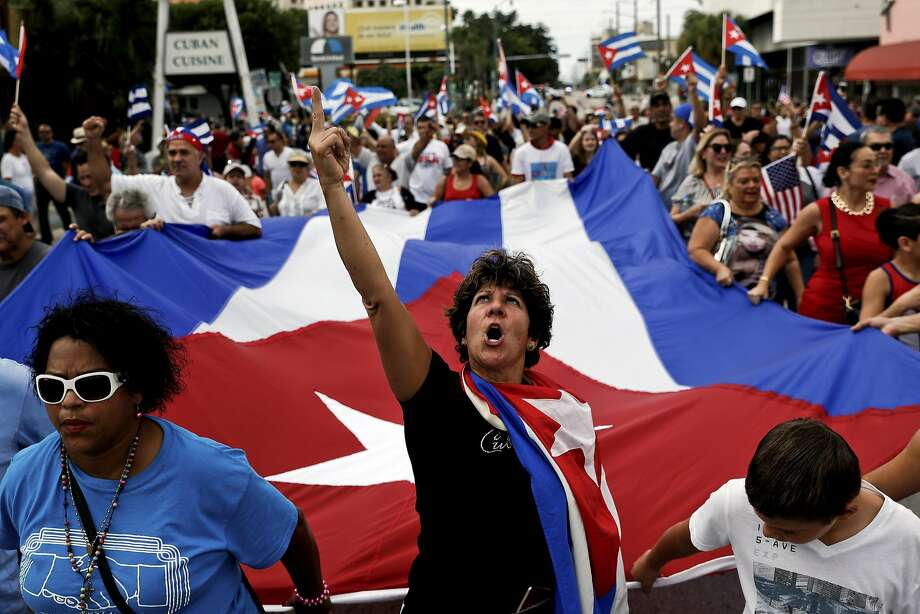 People celebrate the death of former Cuban President Fidel Castro in the Little Havana neighborhood of Miami. Photo: SCOTT MCINTYRE, NYT