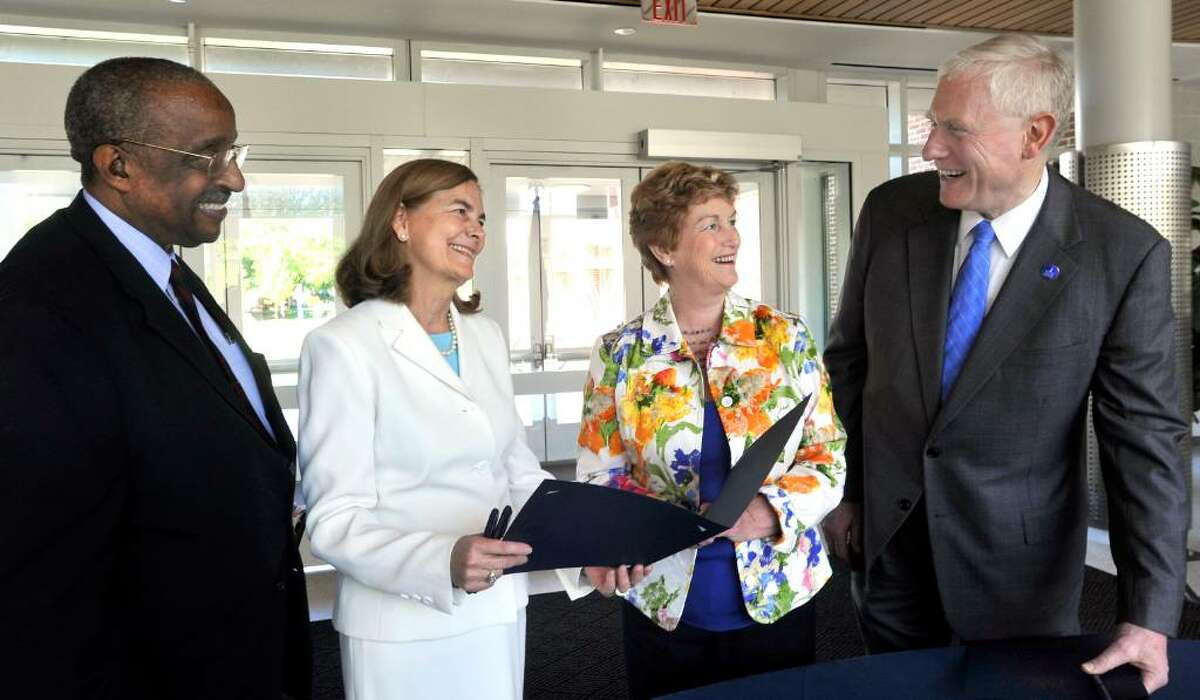 CSUS chancellor Dr. David Carter, left, Chief Nursing Officer of Danbury Hospital, Moreen Donahue, Gov. M. Jodi Rell and WestConn President James Schmotter talk just after the governor signed a bill that creates a doctoral degree to teach nursing at WestConn, in Danbury on Thursday, May 20, 2010.