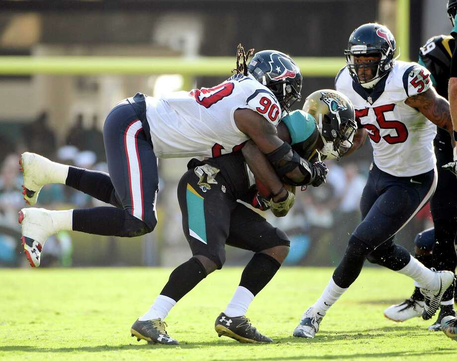 In a Sunday, Nov. 13, 2016 file photo, Jacksonville Jaguars running back T.J. Yeldon, center, is tackled by Houston Texans defensive end Jadeveon Clowney (90) after a short gain during the second half of an NFL football game in Jacksonville, Fla. is having the best season of his three-year career and is tied for second in the NFL with a career-high 12 tackles for losses. Photo: Phelan M. Ebenhack, AP / FR121174 AP