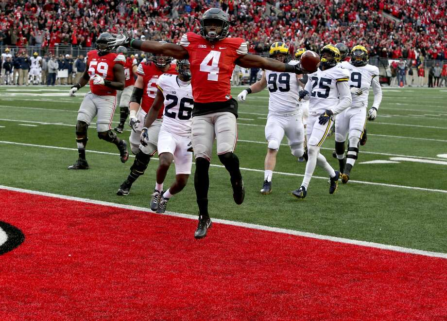 Ohio State's Curtis Samuel jumps for joy and into the end zone in the second overtime to clinch a 30-27 win against Michigan. Photo: Eric Seals, TNS