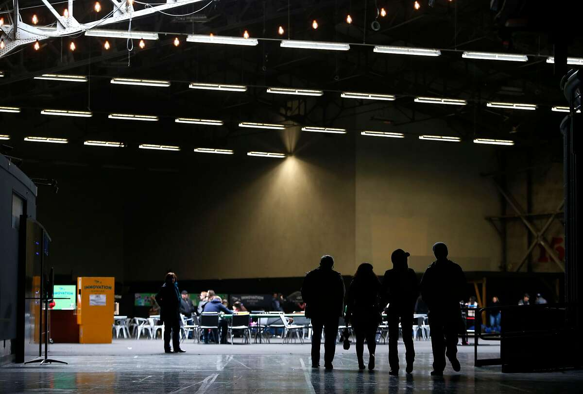 Visitors walk through the Innovation Hangar in the space which once was the home of the Exploratorium at the Palace of Fine Arts in San Francisco, Calif. on Saturday, Nov. 26, 2016.