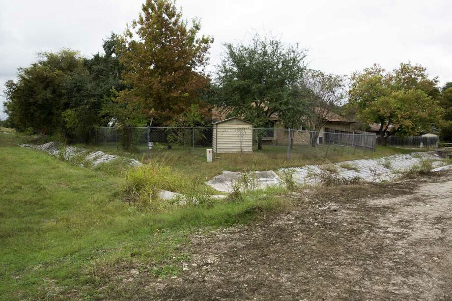 A drainage ditch behind Dave McConkey's home probably was built too small to handle the speed of water that flows through it. Photo: Carolyn Van Houten / San Antonio Express-News / 2016 San Antonio Express-News