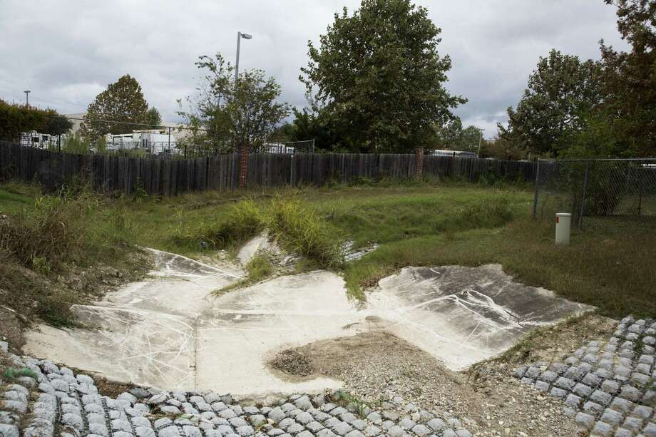 The drainage ditch next to the alley behind Dave McConkey's home, which has flooded multiple times, in San Antonio, Texas on November 22, 2016. Photo: Carolyn Van Houten / Carolyn Van Houten / 2016 San Antonio Express-News