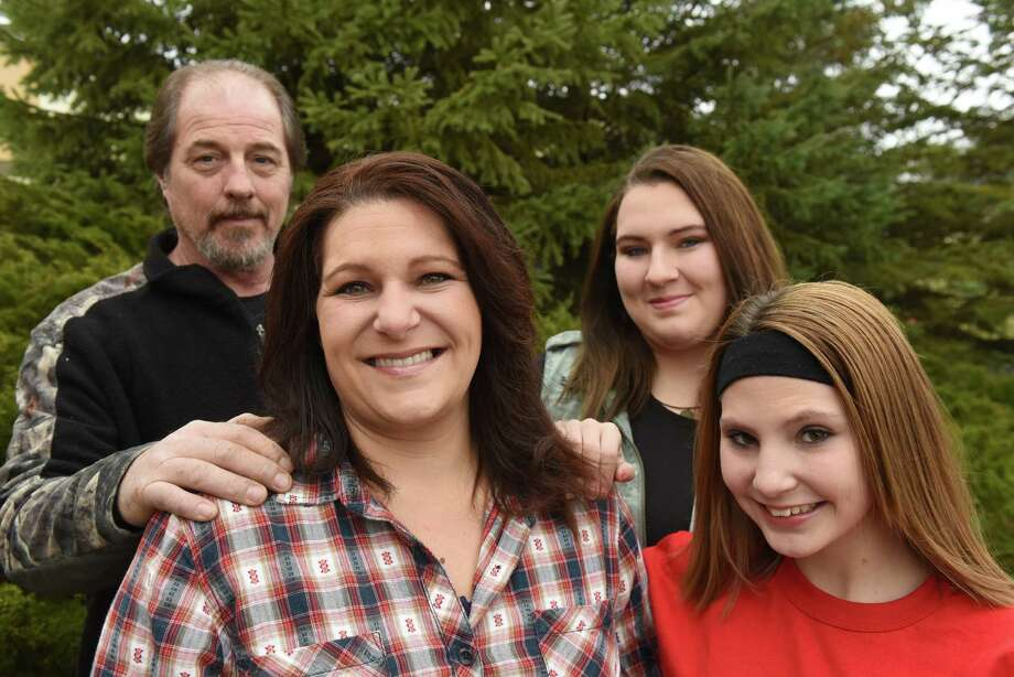 Larry Wikins, left, with girlfriend Autumn Cardente and her daughters Michelina Cardente, 12, right, Isabella Cardente, 17, and on Friday Nov. 25, 2016 in Mechanicville, N.Y.  (Michael P. Farrell/Times Union) Photo: Michael P. Farrell / 20038942A