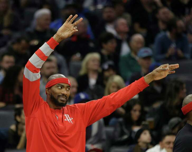 Rockets forward Corey Brewer celebrates on the bench after teammate Trevor Ariza converted a 3-pointer against the Kings during the first quarter Friday.