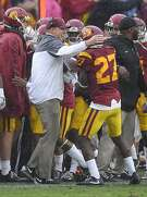 Southern California head coach Clay Helton, left, congratulates defensive back Ajene Harris after Harris intercepted a pass and ran it in for a touchdown during the first half of an NCAA college football game against Notre Dame, Saturday, Nov. 26, 2016, in Los Angeles. (AP Photo/Mark J. Terrill)