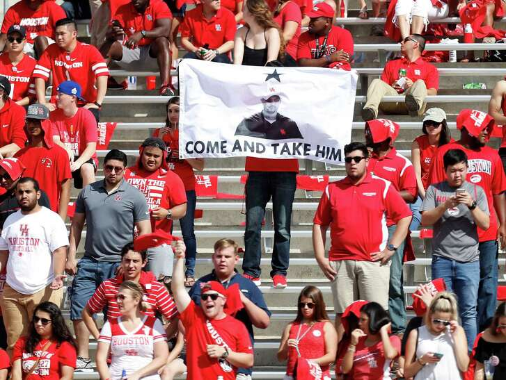 "A fan holds a flag reading ""Come and Take Him"" with a picture of Houston Cougars head coach Tom Herman on it in the stands during the second quarter of a college football game at TDECU Stadium, Saturday,Oct. 29, 2016 in Houston.   ( Karen Warren / Houston Chronicle )"