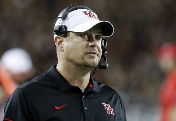 FILE - In this Sept. 15, 2016, file photo, Houston coach Tom Herman stands on the sideline during the first half of an NCAA college football game against Cincinnati in Cincinnati. A person with direct knowledge of the discussions says Herman has told the school he is leaving to become the next coach of the Texas Longhorns. Herman would replace Charlie Strong, who was fired Saturday, Nov. 26, 2016, after three consecutive losing seasons at Texas. The person confirmed Herman's move to Texas on condition of anonymity because neither school had yet publicly announced the decision. (AP Photo/John Minchillo, File)