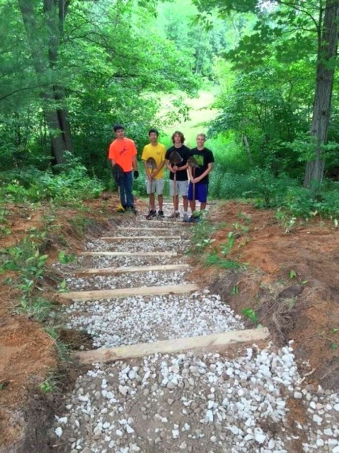 Timothy Su and friends stand at the staircase to the sledding hill at City Forest they had built as part of an Eagle Scout project in this submitted photo.