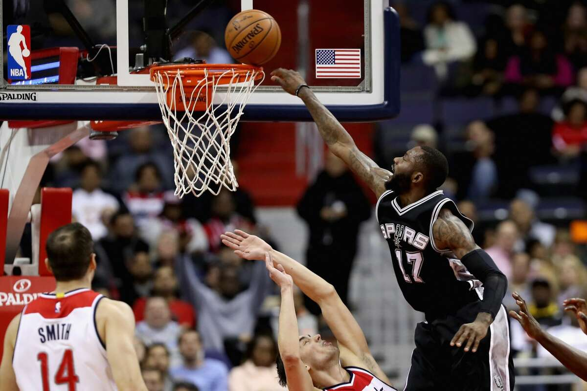 WASHINGTON, DC - NOVEMBER 26: Jonathon Simmons #17 of the San Antonio Spurs shoots over Tomas Satoransky #31 of the Washington Wizards at Verizon Center on November 26, 2016 in Washington, DC. NOTE TO USER: User expressly acknowledges and agrees that, by downloading and or using this photograph, User is consenting to the terms and conditions of the Getty Images License Agreement. (Photo by Rob Carr/Getty Images)