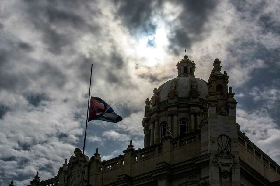 The Cuban flag flies at half-mast outside the Museum of the Revolution, formerly the presidential palace, in Havana, Cuba, Saturday, Nov. 26, 2016, one day after Fidel Castro's death. Cuba will observe nine days of mourning for the former president who ruled Cuba for half a century.  (AP Photo/Desmond Boylan) Photo: Desmond Boylan, STR / Copyright 2016 The Associated Press. All rights reserved.