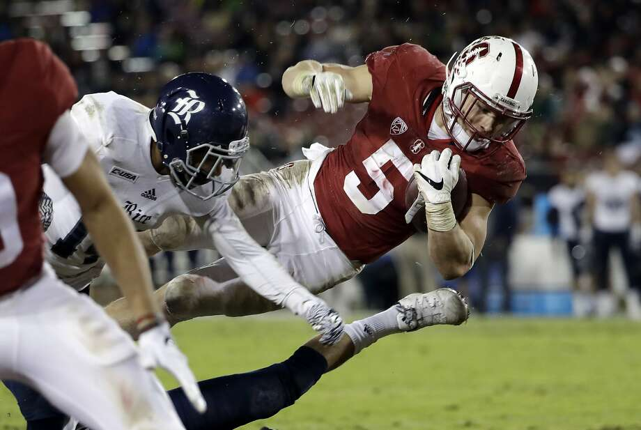 Cardinal RB Christian McCaffrey leaps into the end zone on a 23-yard TD reception during the first half. Photo: Marcio Jose Sanchez, Associated Press