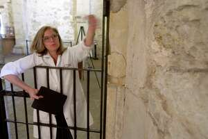 Alamo conservator Pam Rosser talks about the deterioration of walls inside the Confessional Room of the Alamo church on Nov. 22, 2016.