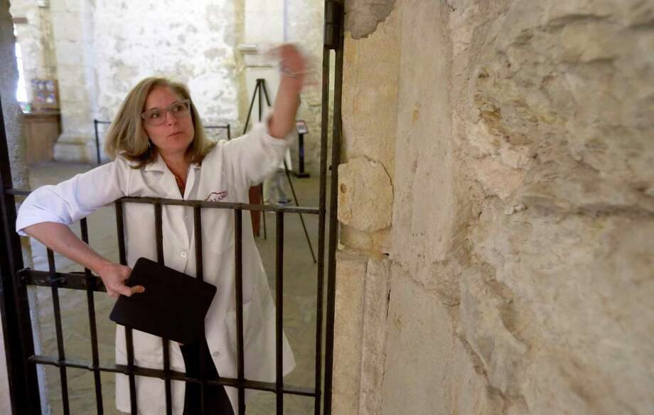 Conservator Pam Rosser talks  about the deterioration of walls inside the a confessional room at the Alamo church. Photo: William Luther / San Antonio Express-News / © 2016 San Antonio Express-News