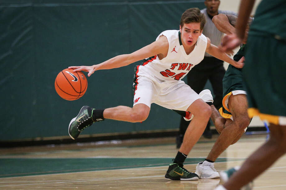 The Woodlands' Gabe Carbajal (24) controls the ball during the varsity boys basketball game against Klein Forest on Saturday, Nov. 26, 2016, at The Woodlands High School. (Michael Minasi / Chronicle) Photo: Michael Minasi, Staff / © 2016 Houston Chronicle