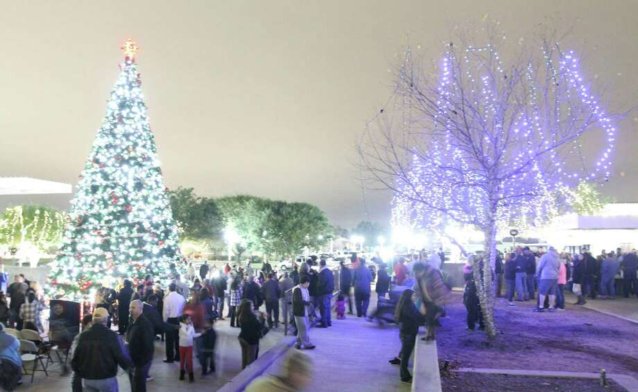 In this file photo, Visitors walk around Heritage Place Park during the annual Christmas tree lighting in downtown Conroe, Photo: Jason Fochtman, Staff Photographer / Houston Chronicle